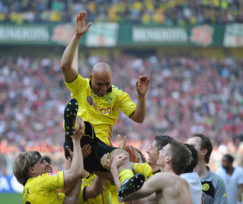 DORTMUND, GERMANY - APRIL 30:  Dede of Dortmund is tossed in the air by players after winning the league title at the end of the Bundesliga match between Borussia Dortmund and 1. FC Nuernberg at Signal Iduna Park on April 30, 2011 in Dortmund, Germany.  (Photo by Stuart Franklin/Bongarts/Getty Images)