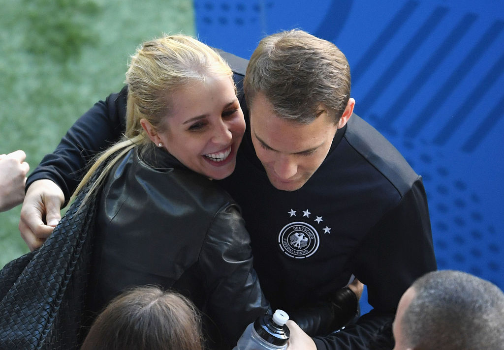 LILLE, FRANCE - JUNE 26:  Manuel Neuer of Germany talks his girlfriend Nina Weiss after the UEFA EURO 2016 round of 16 match between Germany and Slovakia at Stade Pierre-Mauroy on June 26, 2016 in Lille, France.  (Photo by Matthias Hangst/Getty Images)