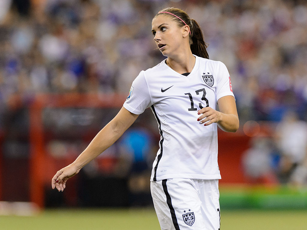 MONTREAL, QC - JUNE 30: Alex Morgan #13 of USA looks on during the 2015 FIFA Women's World Cup semi final match against Germany at Olympic Stadium on June 30, 2015 in Montreal, Quebec, Canada. The United States defeated Germany 2-0 and move to the final round. (Photo by Minas Panagiotakis/Getty Images)