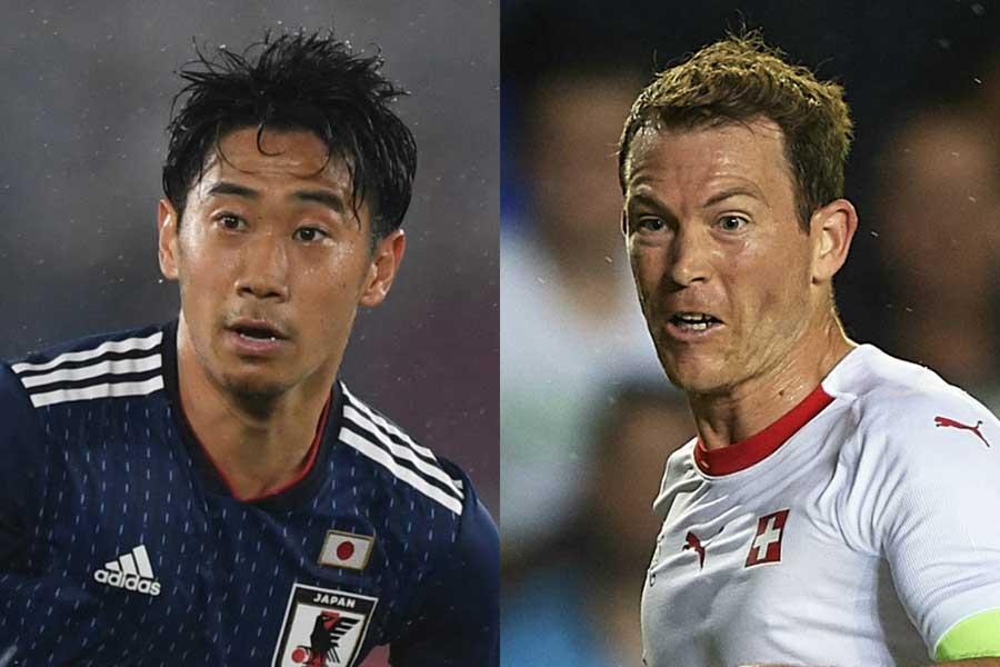 英メディアは勝負のポイントに、香川(左)とリヒトシュタイナー(右)のマッチアップを挙げた【写真:Getty Images】