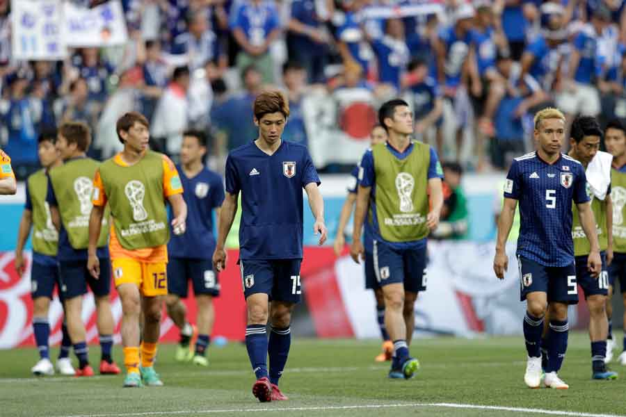 紙一重で決勝トーナメント進出を果たした日本代表に対し、韓国メディアが辛辣な言葉を投げかけている【写真:AP】