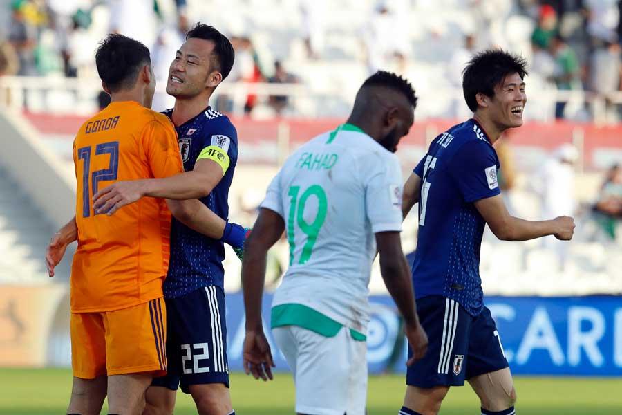 日本代表はシュート15本を許しながら、DF冨安のゴールを体を張って守り抜いた【写真:AP】
