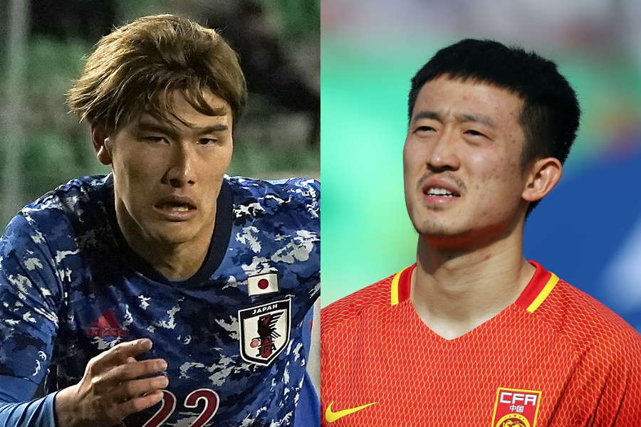 日本代表MF橋岡大樹(左)が中国代表DFジャン・ジーポンのラフプレーの被害に…【写真:Getty Images】